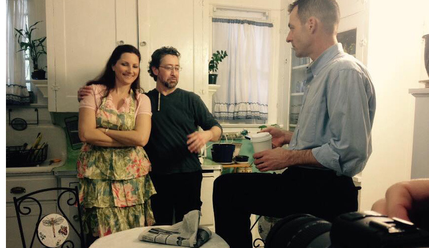 Holly, Joseph and Bill in the kitchen between takes